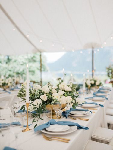 White tabelcloths and settings in an ivory tent at Shuswap Wedding