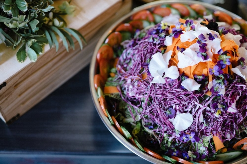 Beautiful green salad with edible flowers